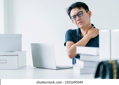 Asian working hard man with office syndrome have problem with part of body arm shoulder head neck back healthy problem ideas concept