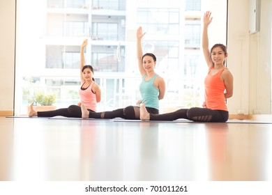 Asian Yoga Class, Group of People Relaxing and Doing Yoga.Wellness and Healthy Lifestyle.