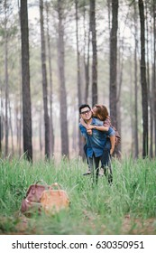 An Asian young adult couple traveling in pine forest, Thailand