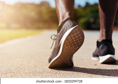 Asian young athlete sport runner black man wear feet active ready to running training at the outdoor on the treadmill line road for a step forward, healthy exercise workout, closeup back shoe
