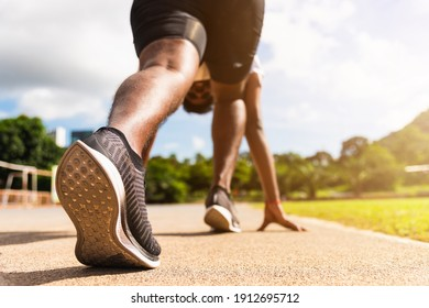 Asian young athlete sport runner black man active ready to start running training at the outdoor on the treadmill for a step forward, healthy exercise workout, closeup back on feet shoe
