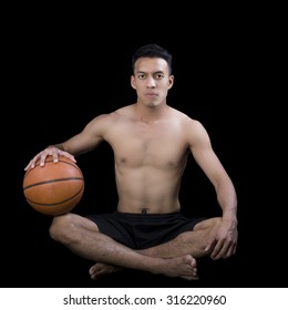 Asian young basketball player on black background