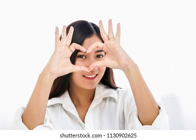 Asian young beautiful seductive woman attractive emotional hands showing heart shape on her hand.
