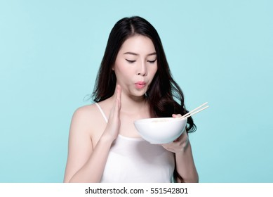 Asian young beautiful woman eating hot and spicy instant noodle,  beauty face natural makeup, isolated over blue background.