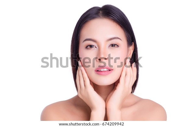 asian young beautiful woman smiling and touching her face, isolated over white background. natural makeup, SPA therapy, skincare, cosmetology and plastic surgery concept