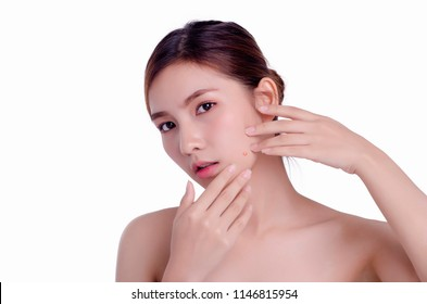 asian young beautiful woman squeezing her pimple, removing pimple from her face. Woman skin care concept. Acne spot pimple spot skincare beauty care girl pressing on skin problem face.