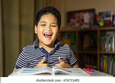 Asian Young boy doing homework