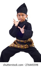 Asian young boy training a pencak silat, Malay traditional discipline martial art isolated on white background