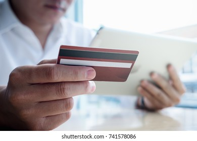 asian young business hands holding credit card and using laptop smart phone Online shopping Website,Article, Blog.Easy Ecommerce Website Shop Online by Smartphone.Online shopping concept