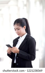 Asian young business people are using smartphones, 5g communication technology, the user does not miss the important moments negotiated between partners.