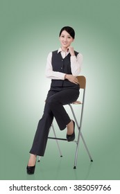 asian young business woman sit on a chair, full length portrait