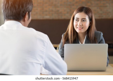Asian young businesswoman attending listening to employee is talking at office.