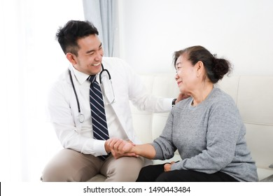 Asian young Doctor talking with Senior woman in hospital