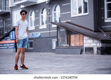 Asian young fashion man sunglasses outdoors in the city