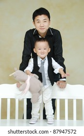 Asian young father  with cute child