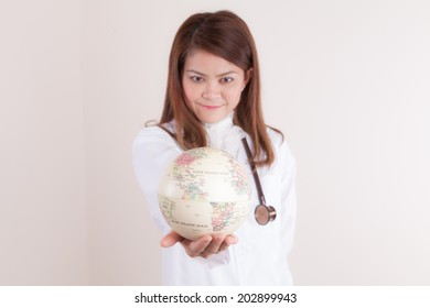 Asian Young  Female doctor showing globe on her hand