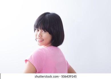 Asian young girl smile closeup gary background