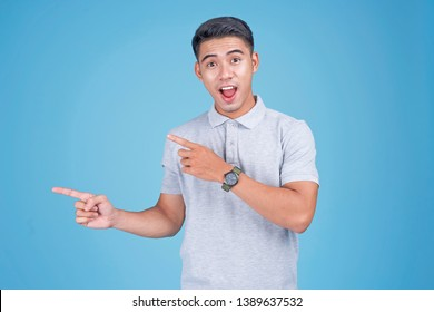 Asian young handsome man with hand gesture on light blue background
