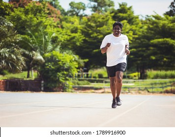 Asian young lifestyle athlete sport runner black man wear feet shoe active running training at the outdoor on the treadmill line road, healthy exercise workout