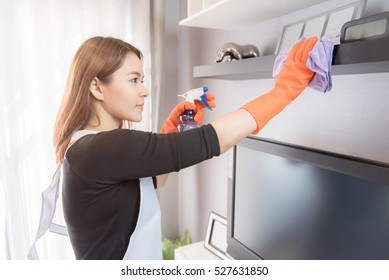 Asian young maid cleaning at home, Cleaning service concept