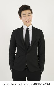 Asian young man in a black suit