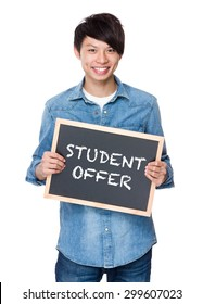 Asian young man with chalkboard showing student offer
