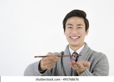 Asian young man with chopsticks