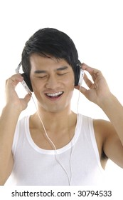 Asian young man feeling the music
