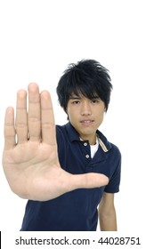 Asian young man making stop with his hand