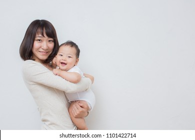 asian young mom with baby
