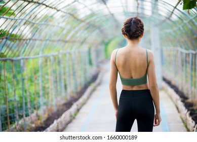 Asian young runner, braided hair, warm up, stretching before exercise and amid bamboo tunnels. Exercise, active women in the city concept