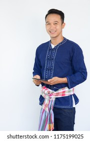 """Asian young smart  farmer on a  Indigo traditional shirt """"Mauhom shirt"""" is kind of shirt in northern Thailand"""
