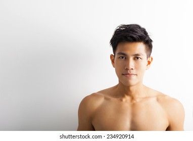 asian young sport man with perfect fitness body