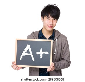 Asian young student with blackboard showing sign of A plus