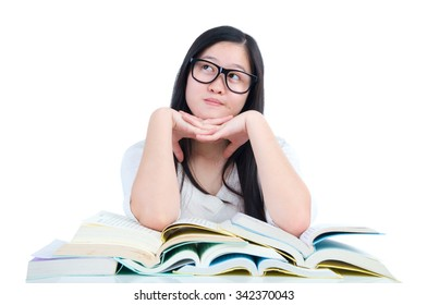 Asian young student girl thinking with book over white background