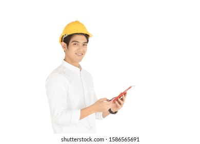 Asian young technician wearing yellow safety helmet holding a credit card and tablet close up.  Concept of financial and transaction in modern society.