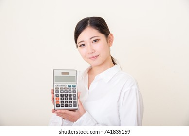 asian young woman with calculator
