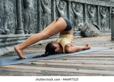 Asian young woman doing yoga in abandoned temple