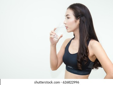 Asian young woman drinking water, on white background (drink)