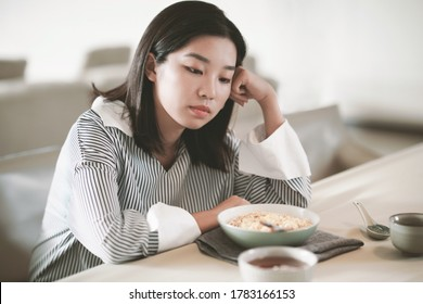 Asian young woman eating food