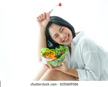 Asian young woman eating salad on white background diet food concept