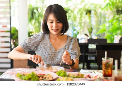 asian  young woman enjoy eating with thai food