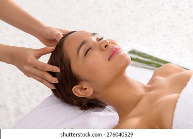 Asian young woman enjoying scalp massage