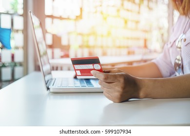 asian young woman hands holding credit card and using laptop Online shopping.Online shopping concept