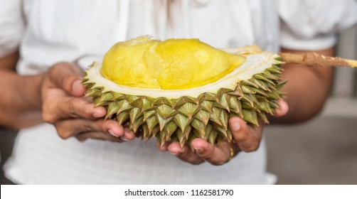 Asian young woman holding Durian is a king of fruit in Thailand and asia fruit