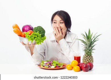 Asian young woman holding fresh ingredients and happiness for healthy salad or green fresh ingredients.