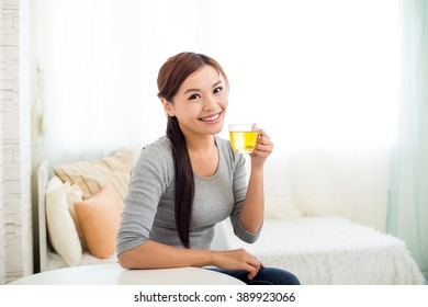 Asian young woman holding tea cup