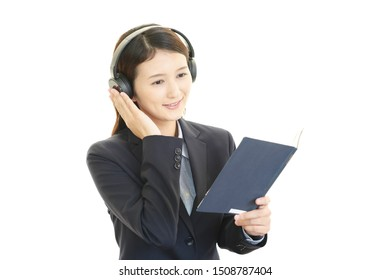 Asian young woman listening to music.