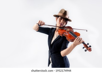 Asian young woman musician playing the classical music violin on white background in studio.