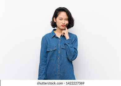 Asian young woman over isolated white background Looking front